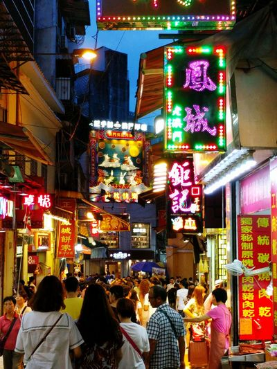 Street Neon Lights Tourist Destination People Walking  People And Places. Colorful Lights