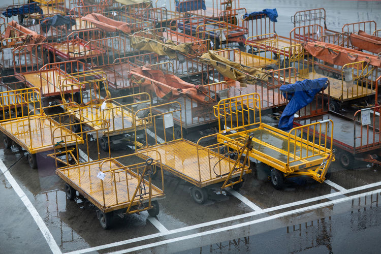 High angle view of trolleys on land