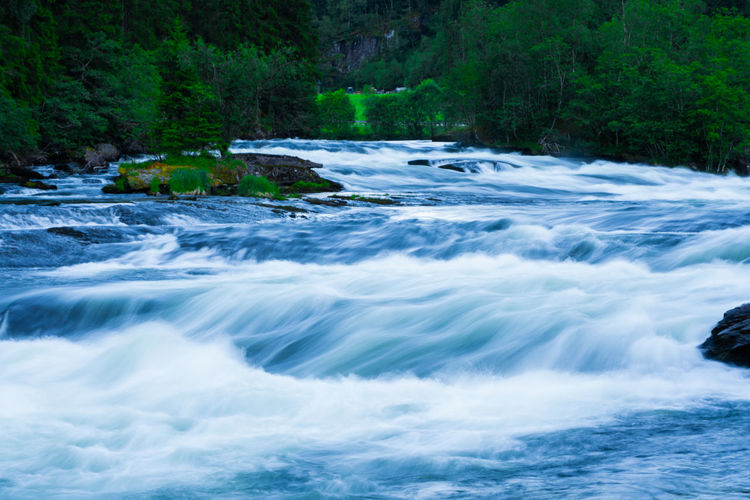River Gaula flowing down, waiting for the salmons to arrive. Green Beauty In Nature Blue Blurred Motion Dusk Flowing Water Forest Long Exposure Motion Nature No People Outdoors Power In Nature River Running Water Scenics - Nature Stream - Flowing Water Tree Water Waterfall