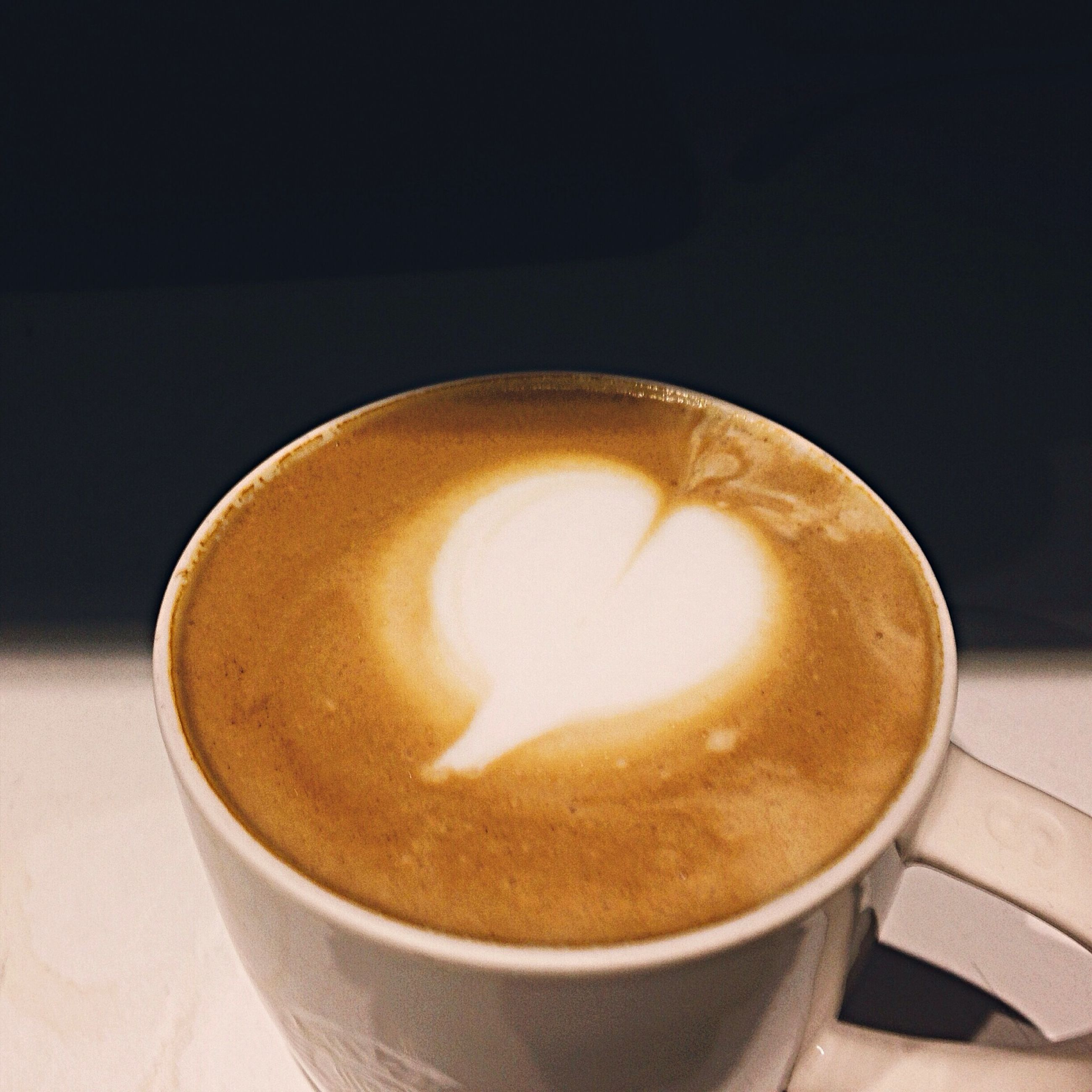 drink, refreshment, food and drink, coffee cup, frothy drink, coffee - drink, cappuccino, saucer, indoors, froth art, coffee, freshness, table, close-up, still life, beverage, cup, latte, froth, no people