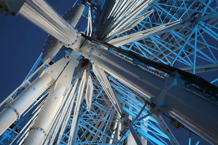 Low Angle View Of Ferris Wheel At Night