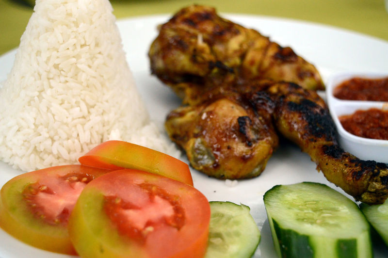 grilled chicken with rice and vegetables Chicken Wings Cucumberslices Food Meat Rice Sauce Tomatoes Vegetable This Is Latin America