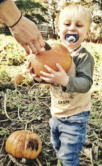 Happiness Casual Clothing Smiling Childhood Day Outdoors Holding Fun Blond Hair Child Portrait Cheerful Standing Real People One Person People Close-up Check This Out Darryn Doyle Growth Fall Beauty Agriculture Pumpkin Freshness One Boy Only