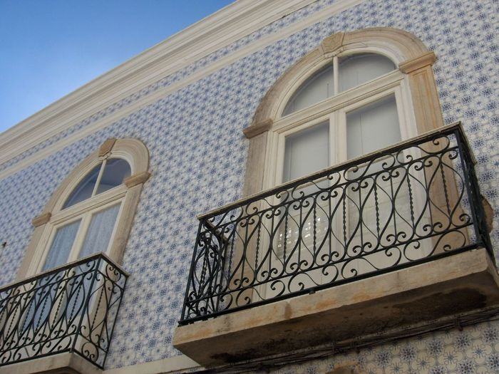 Arch Architecture Building Building Exterior Built Structure Clear Sky Day Design Façade Low Angle View No People Outdoors Pattern Portugal Railing Residential Building Residential Structure Staircase Steps Sunlight Window