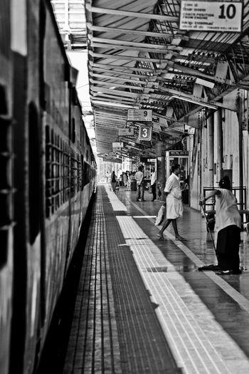 People Waiting On Railway Station Platform