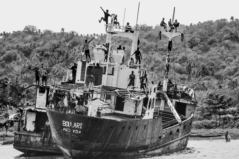 Ahoy Black And White, Boat Wreck Rabaul, East New Britain, Papua New Guinea Day Nautical Vessel Outdoors Waving Locals