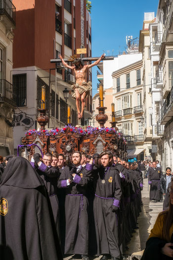 People in the procession in the Holy Week (Semana Santa) in a Spanish city. Malaga, Spain - March 26, 2018. Catolic Church Children Easter Easter Ready Historical Building Holy Week Malaga People Watching SPAIN Semana Santa Spanish Uniform Uniforms Catolicism España Musical Instrument Musician Musician Bands Old Buildings Procession Sabor Spain Is Different Spanish Arquitecture Spanish Culture The Street Photographer - 2018 EyeEm Awards