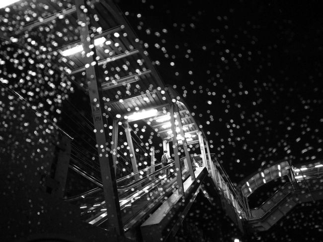 Drizzled With Rain Drizzled Rain Bokeh Photography Bokeheffect Blackandwhite Photography Lonely Urban Lifestyle Trainstations Trainstation By Night Bangkok Thailand. Transportation Escalators And Staircases Escalators Light And Shadow Fluorescent Salaryman Going Up!
