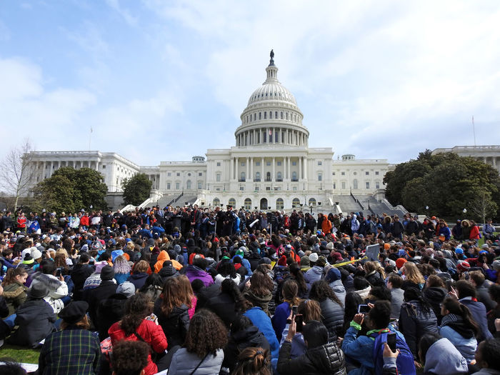 US Congressman John Lewis (D-GA) speaks to hundreds of high school students attending the National School Walkout on the National Mall in front of the US Capitol building, Washington, DC, to demand political action to address gun violence on March 14, 2018. Activists National School Walk Out US Capitol Building Activism Architecture Authority Building Exterior Built Structure City Cloud - Sky Day Dome Government Gun Control Gun Violence High School Students Large Group Of People Outdoors People Protesters Real People Sky Travel Destinations Young Adult