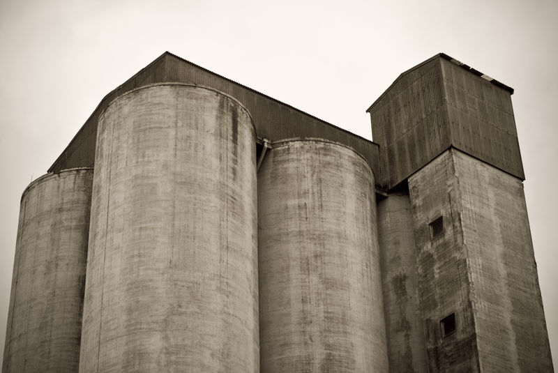 Architecture Building Exterior Built Structure Concrete Day Dystopian Empty Factory Grey Industrial Building  Industry Industry Low Angle View Metal Industry No People Outdoors Silo Silos Sky Storage Storage Compartment Toned Warehouse