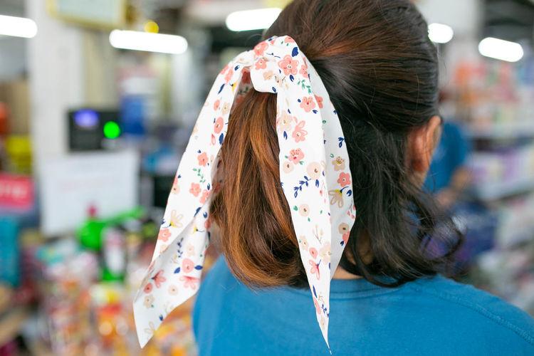 Rear view of woman wearing mask