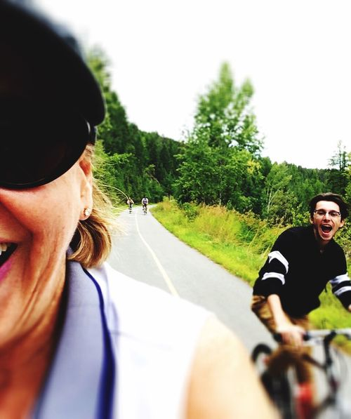 Person Exercise Capturing Motion Two People CyclingUnites Bicycle Mature Adult Day Transportation Outdoors Real People Clear Sky Adult People Cycling Road Only Men Driving Togetherness Nature Young Adult One Person Horizontal