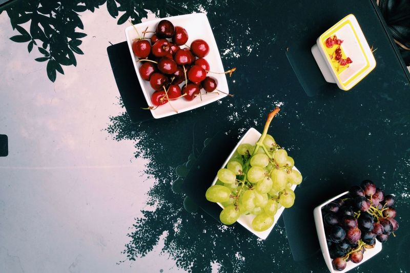 Directly above shot of fruits in container on table