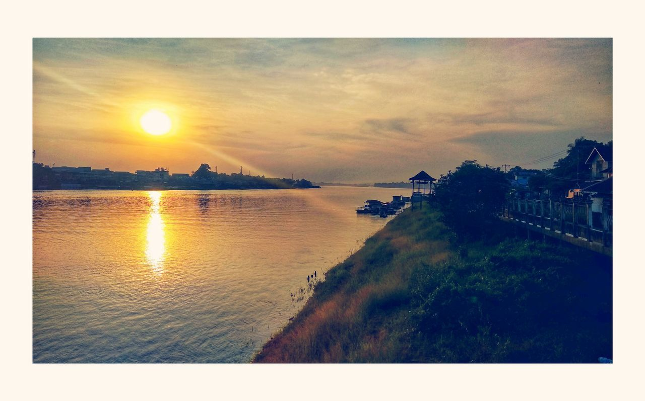 sky, water, auto post production filter, scenics - nature, sunset, cloud - sky, transfer print, nature, sea, sun, beauty in nature, tranquil scene, tranquility, no people, sunlight, outdoors, reflection, architecture, city, lens flare