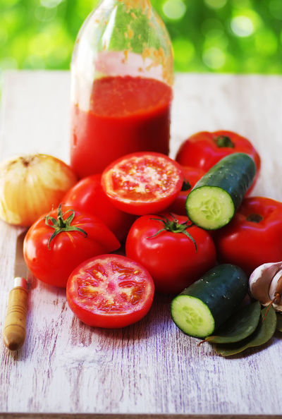 tomatoes and glass bottle of tomato paste on table Tomatoes Up Close Close-up Food Food And Drink Freshness Fruit Healthy Eating High Angle View Pepper Raw Food Red Spice Table Tomato Tomato Paste Vegetable