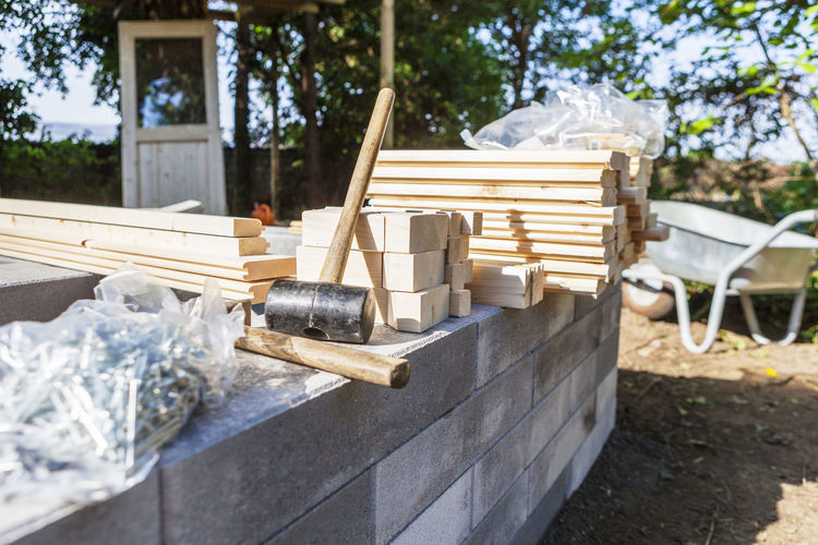 Construction Construction Site DIY Do It Yourself Home Improvement Plan Planning Working Building Building Materials Building Site Concrete Constructing Construction Work Creating Garden Mallet Materials Outdoors Pieces Preparation  Preparing Project Safety Wood - Material