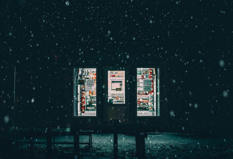 Building seen through window at night