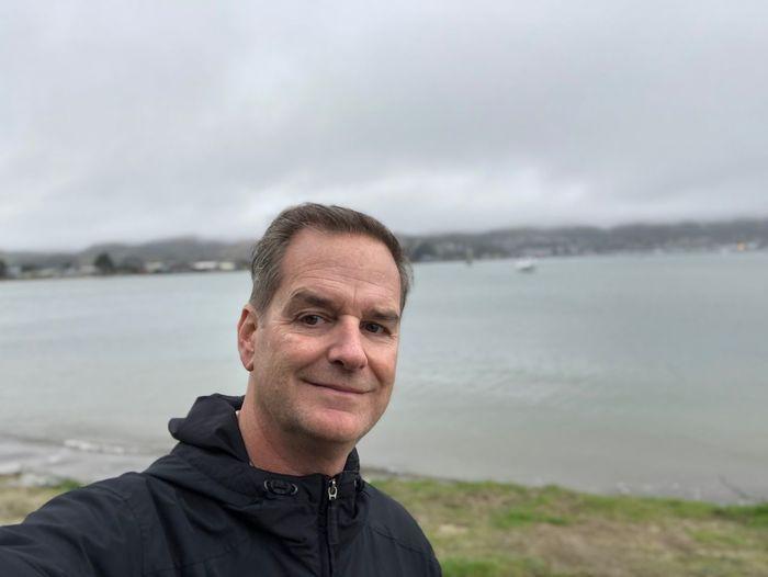 Portrait of man against lake