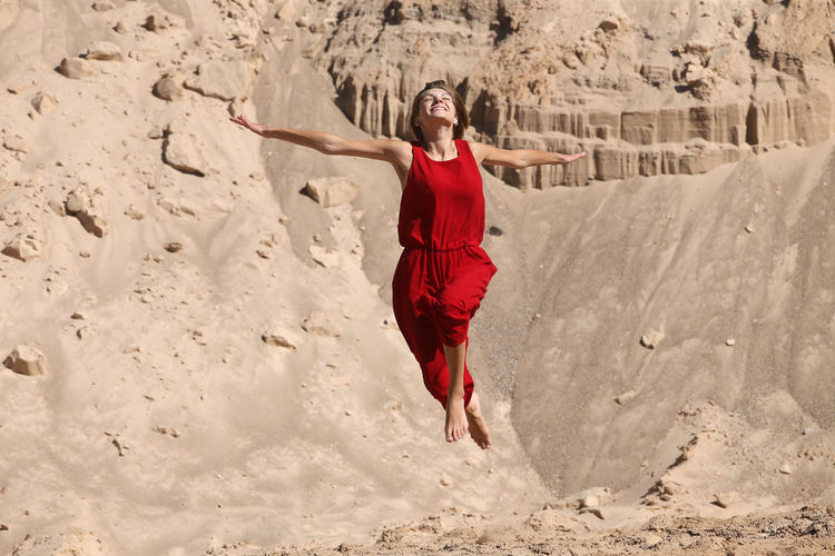 Full length of woman standing on sand