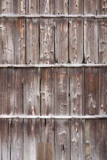 Burned wooden board wall Protection Wood Old Security Door Entrance Day Weathered Pattern Brown Close-up Textured  Safety No People Wood Grain Backgrounds Full Frame Wall - Building Feature Wood - Material Textured Effect Hatamoto Shinichi