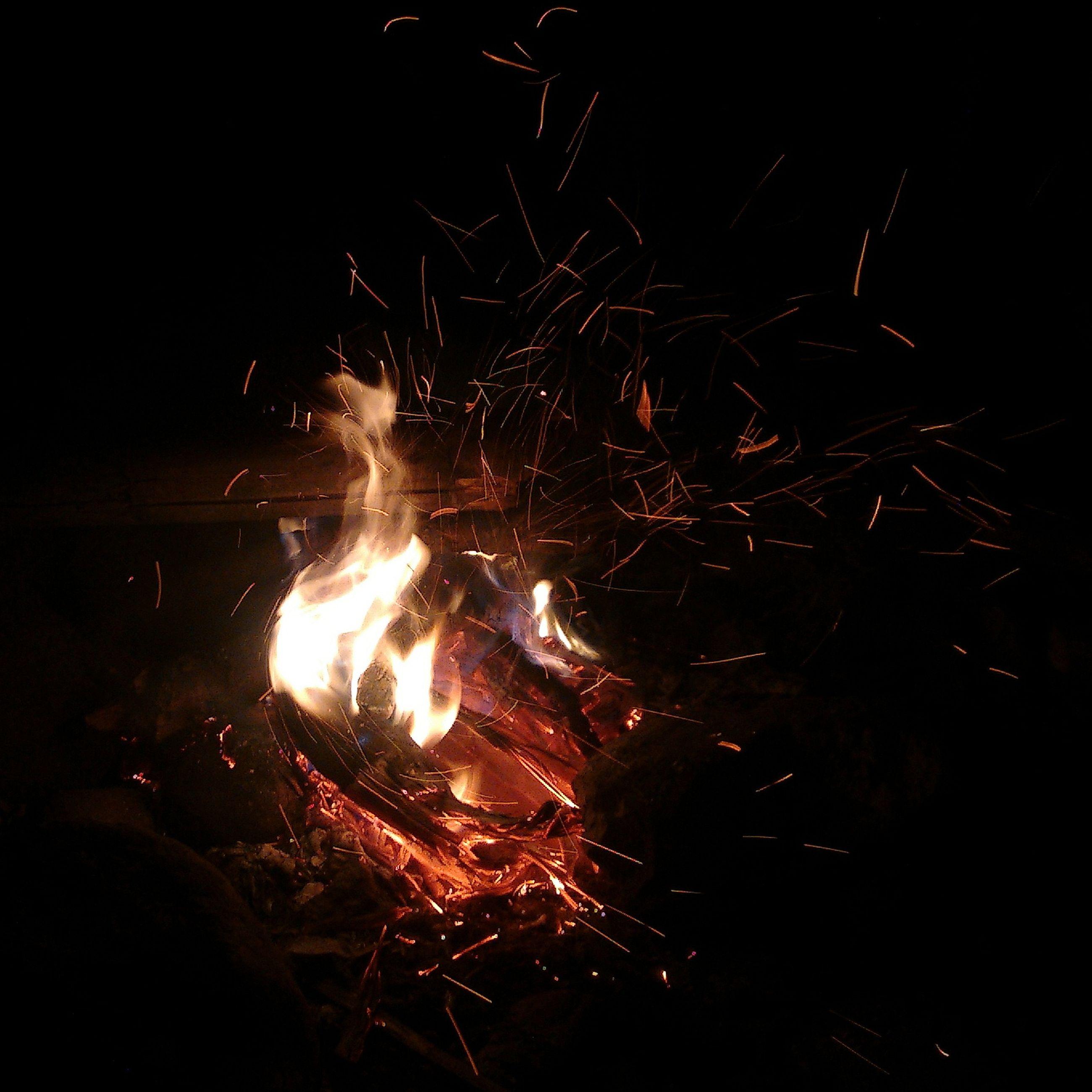 night, illuminated, fire - natural phenomenon, glowing, burning, celebration, long exposure, dark, flame, firework display, motion, light - natural phenomenon, firework - man made object, exploding, heat - temperature, sparks, outdoors, no people, light, bonfire