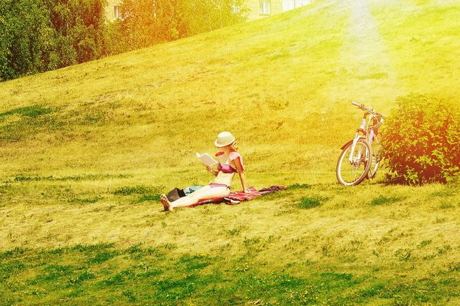 Sunny holiday. Holiday POV Sunny Holiday Girl Reading Bicycle Sun Park Nature Relaxing