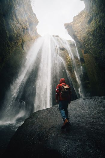 Moving forward. Travel Hike One Person Real People Water Motion Full Length Lifestyles Go Higher Nature Waterfall Beauty In Nature Leisure Activity Standing Long Exposure Flowing Water Day Scenics - Nature Women Splashing Outdoors