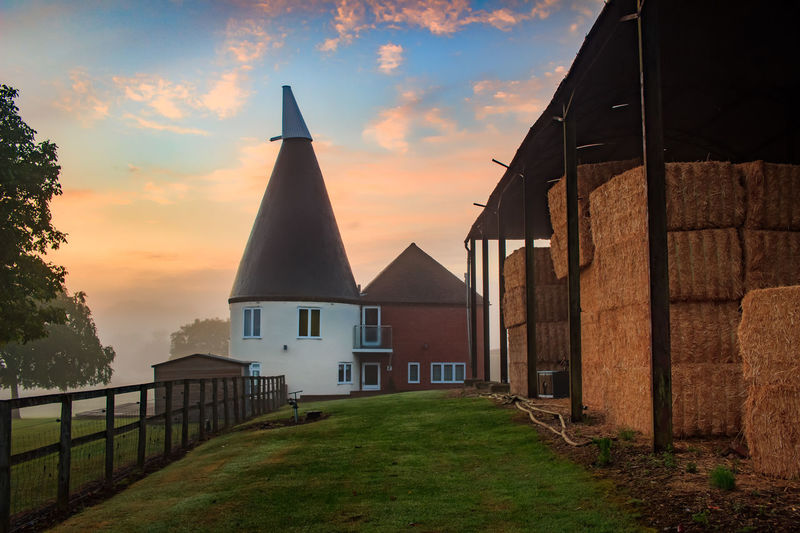 Oast House,Garden of England, Kent, England. Plant Nature No People Built Structure Architecture Building Exterior Outdoors Building Hops Beer Brewing Travel Destinations Tourism Caravan Rural Scene Countryside EyeEm Gallery Vivid International Getty Images Architecture Iconic Buildings Sky Sunset Cloud - Sky Grass Orange Color Place Of Worship Land Religion Field Belief Spirituality