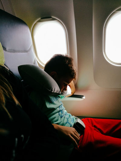 Boy sleeping in airplane