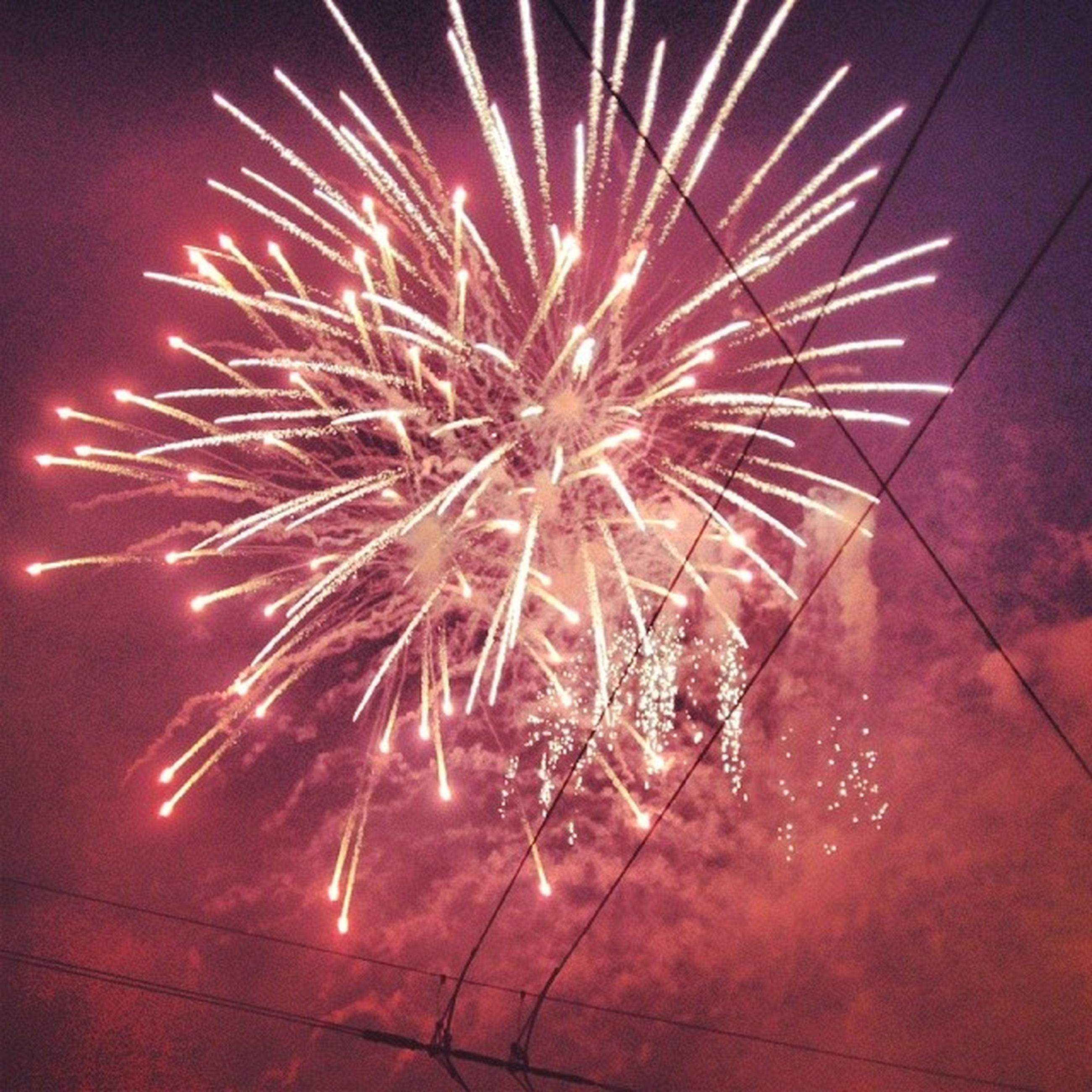night, illuminated, firework display, celebration, exploding, arts culture and entertainment, motion, sparks, firework - man made object, low angle view, event, long exposure, glowing, sky, firework, blurred motion, entertainment, celebration event, red, outdoors