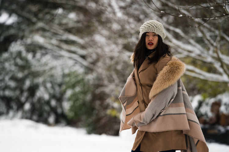 Adult Beautiful People Beautiful Woman Beauty Beauty In Nature Close-up Cold Temperature Day Focus On Foreground Fur Fur Coat Happiness Lifestyles Nature One Person Outdoors Overcoat Real People Smiling Snow Warm Clothing Winter Women Young Adult Young Women