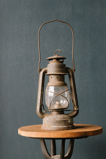 oil lamp vintage item. Indoors  No People Electric Lamp Oil Lamp Lighting Equipment Metal Lantern Still Life Close-up Aged Vintage Oil Pump Lamp Burning Rusty Decoration Retro Styled Chair Traditional Weathered Light Lantern Fashioned Fuel And Power Generation Gas