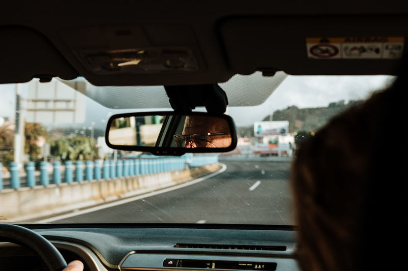 Mode Of Transportation Transportation Car Vehicle Interior Car Interior Glass - Material Motor Vehicle Land Vehicle Windshield Rear-view Mirror Transparent Travel Driving Road Indoors  Day on the move One Person Close-up City