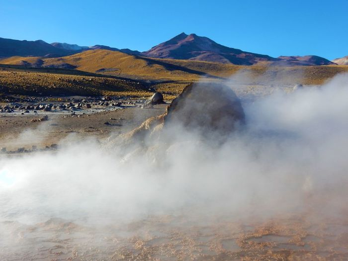 Smoke Emitting From Hot Spring Geyser Against Clear Sky