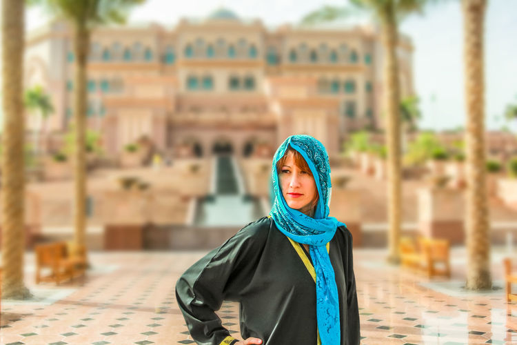 Woman with typical Arab clothes. Luxury vacations and tourism concept. Defocused background at Abu Dhabi, the capital of United Arab Emirates. Holidays, lifestyle and expensive concept. Abu Dhabi UAE United Arab Emirates Woman Abu Dhabi UAE Arab Arabic Architecture Building Exterior Built Structure Close-up Day Emirates Focus On Foreground Front View Looking At Camera One Person Outdoors Palace People Portrait Real People Traditional Clothing Woman Portrait Young Adult Young Women