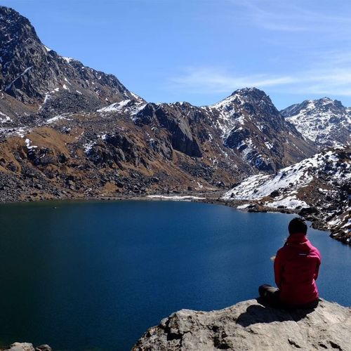 Enjoying the view and silence at Gosaikunda (at an altitude of 4500m) Trekking In Nepal