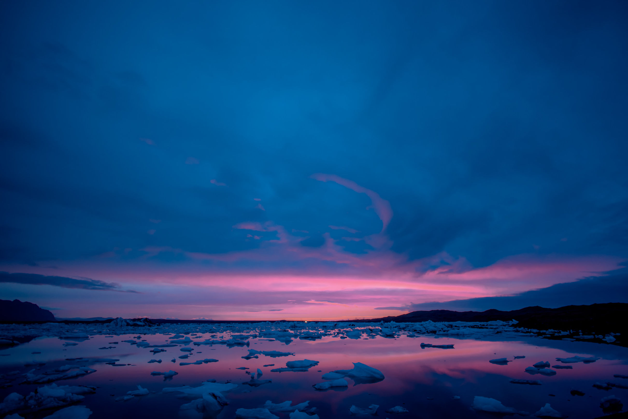 cloud - sky, sky, beauty in nature, scenics - nature, tranquil scene, tranquility, water, no people, nature, idyllic, non-urban scene, blue, sunset, winter, cold temperature, night, snow, dramatic sky, purple