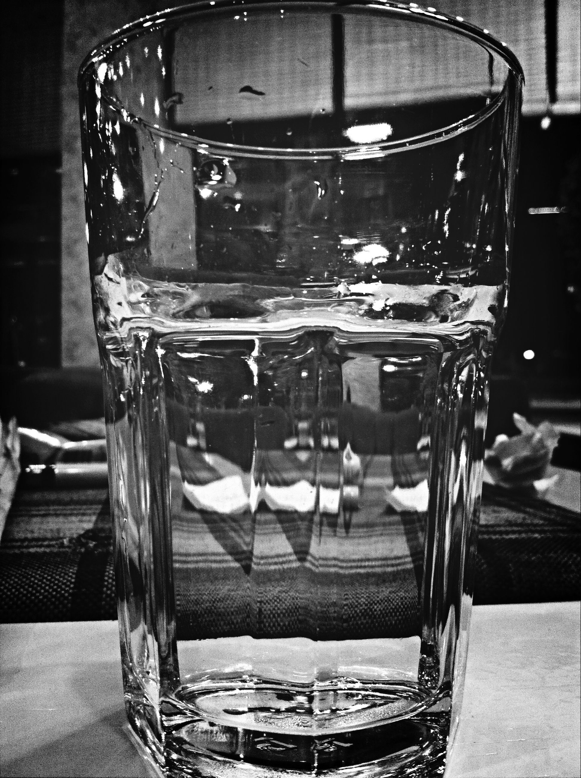 glass - material, indoors, table, drinking glass, transparent, drink, still life, food and drink, glass, refreshment, restaurant, close-up, empty, reflection, no people, focus on foreground, window, day, chair, water