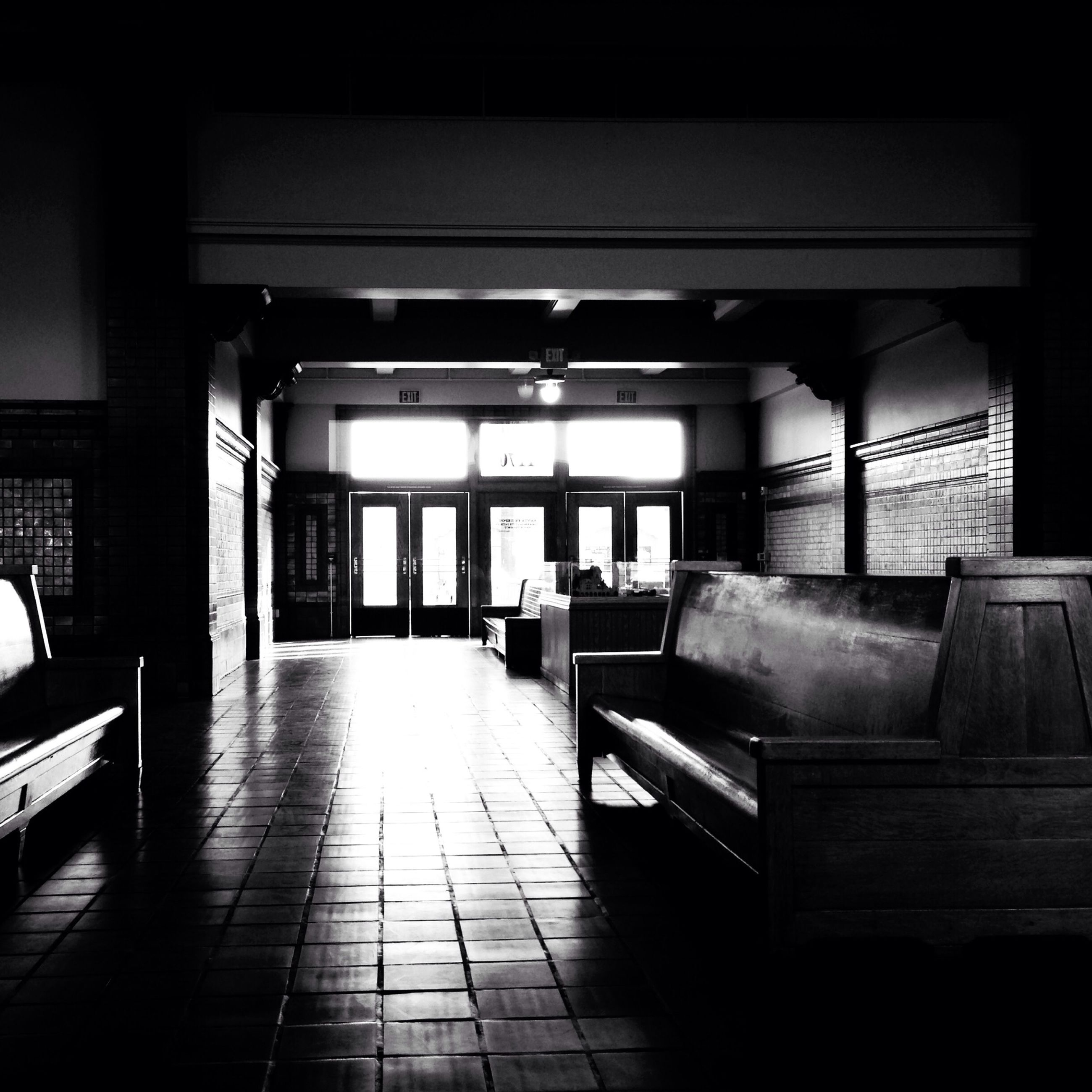 indoors, empty, architecture, built structure, absence, flooring, tiled floor, the way forward, corridor, illuminated, chair, ceiling, interior, door, narrow, transportation, incidental people, no people, railroad station, diminishing perspective
