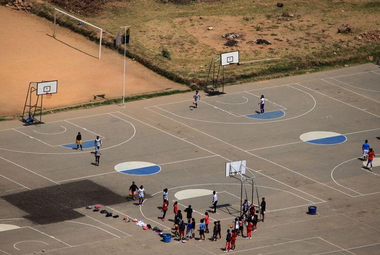 High angle view of people playing basketball