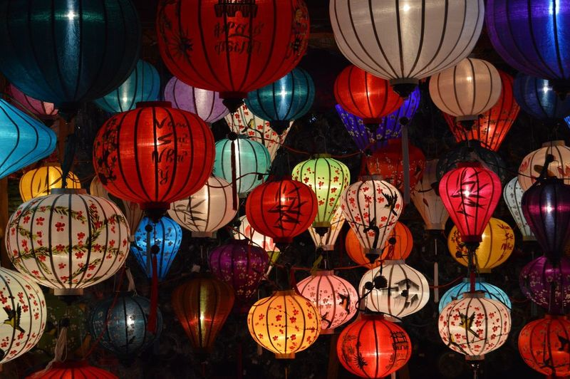 Full Frame Shot Of Illuminated Lanterns Hanging At Night
