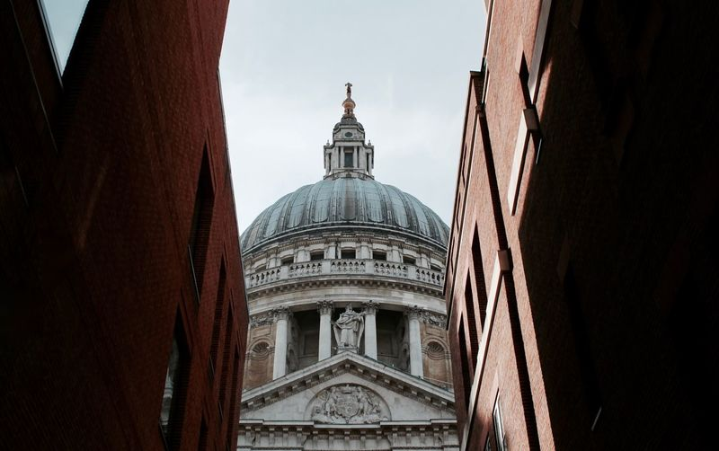 Low angle view of st pauls cathedral and buildings against sky