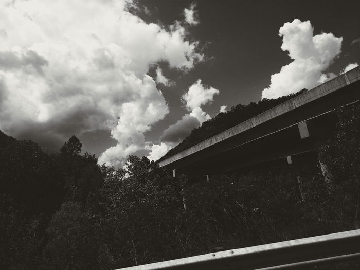 Architecture Beauty In Nature Blackandwhite Bridge Bridge - Man Made Structure Built Structure Cloud Cloud - Sky Cloudporn Clouds Cloudy Day Growth Low Angle View Mobilephotography Nature No People Outdoors PhonePhotography Roadtrip Roof Sky Tranquility Tree Weather