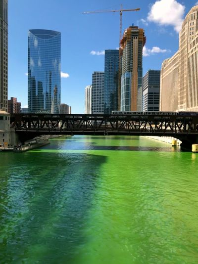St Patrick's day express Chicago Architecture Built Structure Building Exterior Water City Building Office Building Exterior Skyscraper Sky Bridge Waterfront Modern Bridge - Man Made Structure River Urban Skyline Landscape Day Connection No People Tall - High Outdoors Cityscape Financial District  Train - Vehicle Rail Transportation Urban City Cityscape