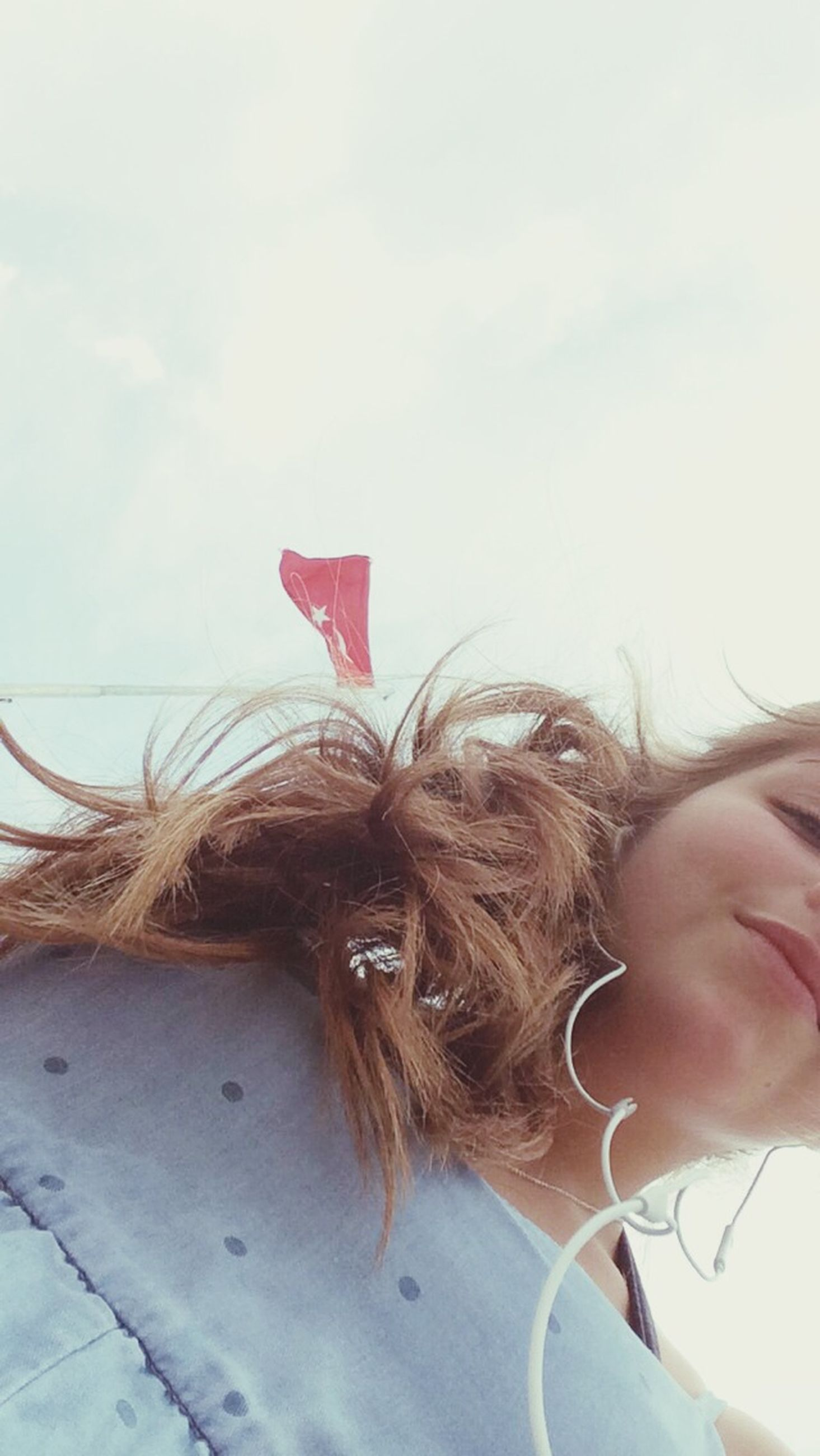 lifestyles, leisure activity, young women, sky, young adult, headshot, person, part of, long hair, cropped, close-up, holding, day, wind