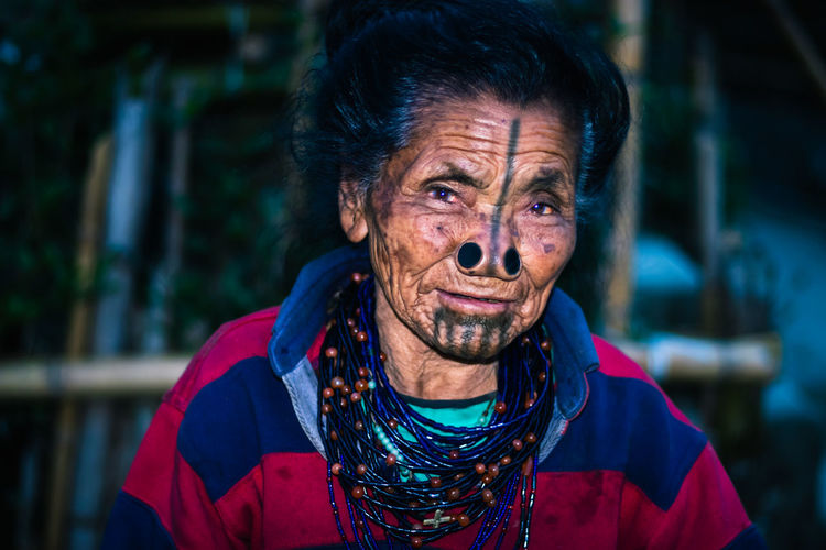 Portrait of smiling senior woman outdoors