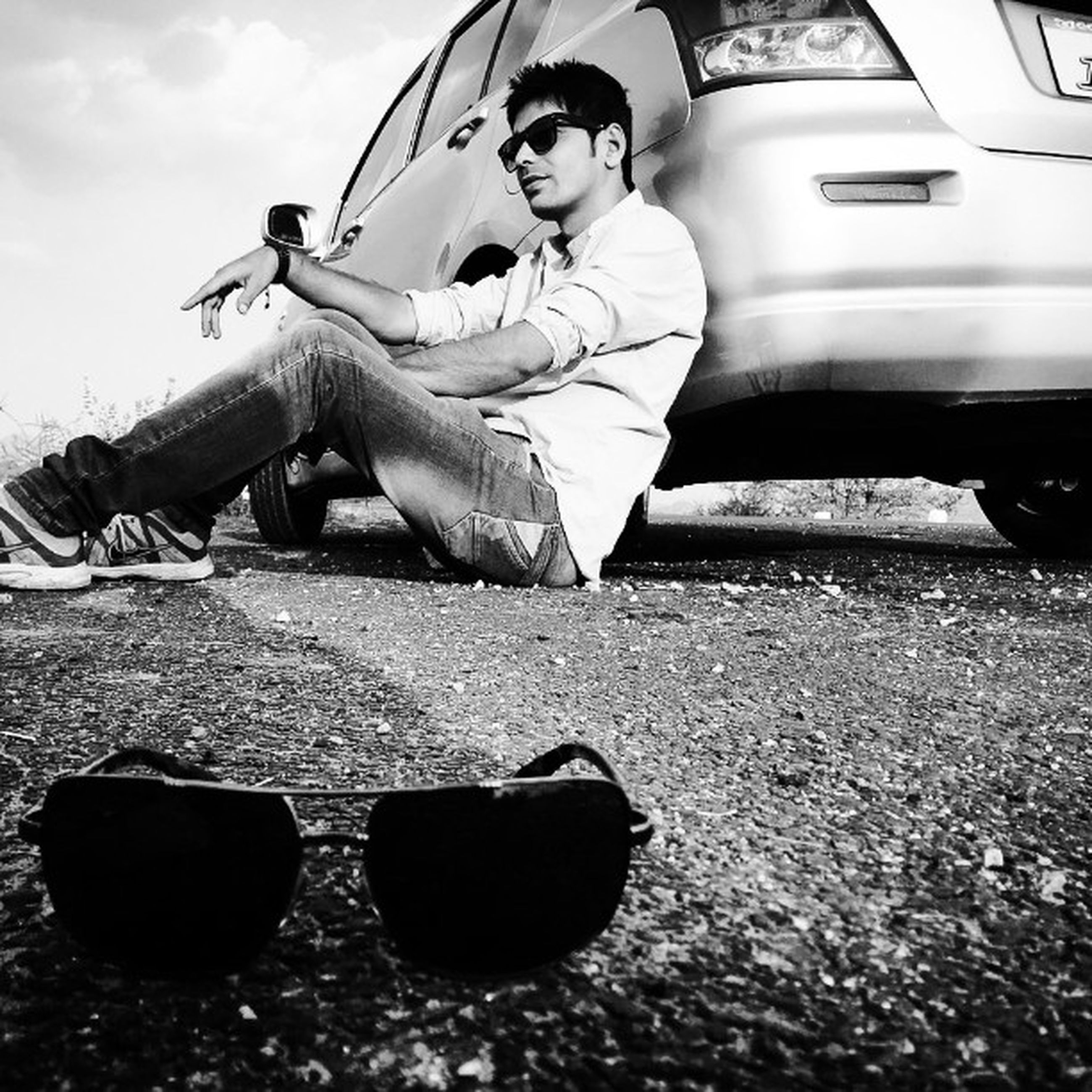 transportation, mode of transport, land vehicle, car, full length, lifestyles, travel, sky, leisure activity, men, day, street, casual clothing, outdoors, human representation, sitting, sunlight, low angle view