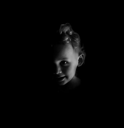 From the darkness comes trouble. Black Background Beautiful Woman Studio Shot Women Portrait Beauty Spooky Headshot Close-up Mystery Darkroom Candlelight