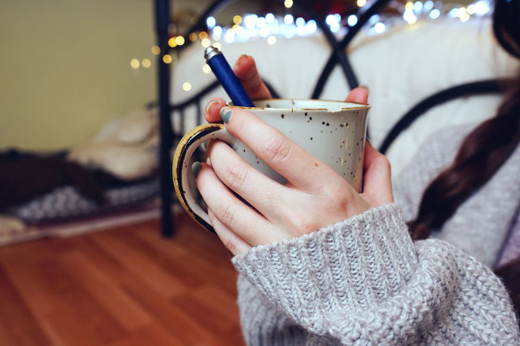 Close-up Coffee - Drink Coffee Cup Day Drink Focus On Foreground Food And Drink Freshness Holding Human Body Part Human Hand Indoors  Leisure Activity Lifestyles One Person People Real People Table Winter Women