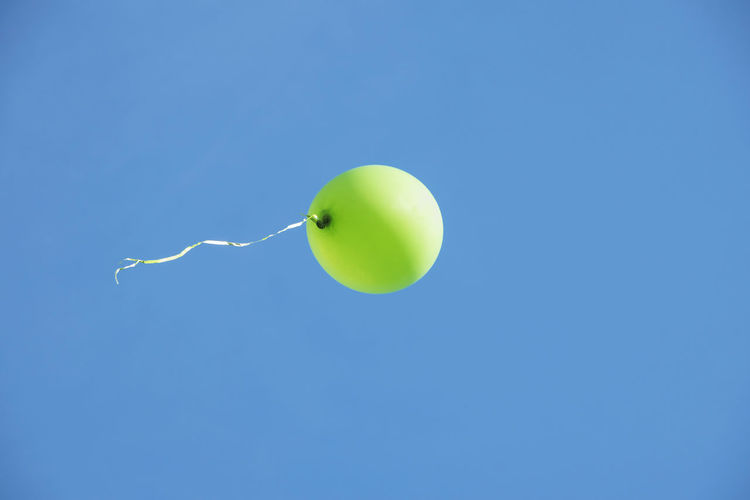 Green air balloon flying away in blue sky Copy Space Flying Blue Background Single Object Nature Motion Day Mid-air Clear Sky No People Low Angle View Sky Green Color Blue Balloon Air Balloon Fly Away Flying Away Leaving Holiday Celebration Party